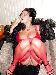 Busty stocking and lingerie clad MILF Linsey Dawn McKenzie having a smoke