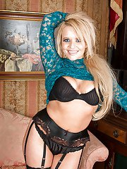 Stocking and garter attired mature blonde showing off nice ass and big tits