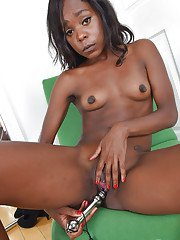 Mature black woman toys and masturbates shaved ebony pussy after undressing