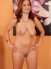 Redhead babe Jessica Red unveiling big MILF tits and trimmed vagina