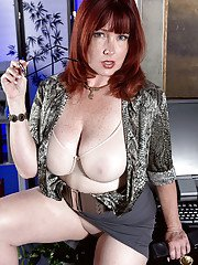 Freckled redhead Heather Barron unleashing large mature tits from lingerie