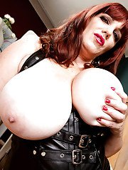 Leather garbed mature redheaded BBW Roxee Robinson playing with own nipples