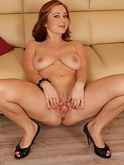 Busty European redhead Jessica Red spreading pussy lips in high heels