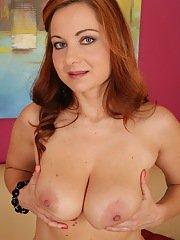 Older Euro dame Jessica Red baring big boobs before masturbating