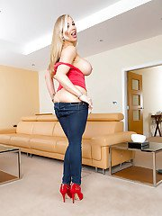 Jeans and high heel clad European MILF Rebecca Moore exposing huge boobs