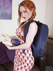 Redheaded Euro babe Ella Hughes exposing phat schoolgirl ass in glasses