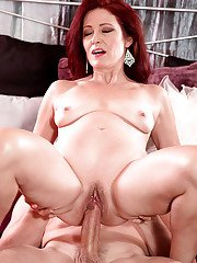 Small boobed mature redhead Dana Devereaux taking hardcore facial cumshot