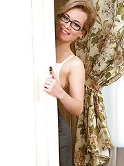 Glasses clad older lady Lisa Young freeing twat from beneath skirt