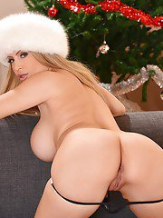Blond babe Anastasia Sweet showing off big tits and thong clad ass at X-mas