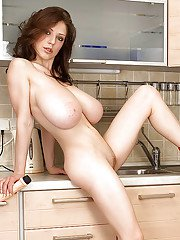 Solo girl Merilyn Sakova unleashing massive all natural juggs in kitchen