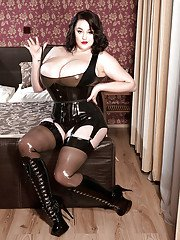 Brunette plumper Lila Payne freeing massive juggs in stockings and garters