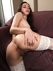 Stocking and high heel clad solo girl pulling down undies to bare MILF bush