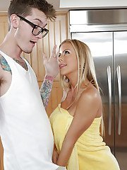 Busty blonde cougar pornstar Alexis Fawx giving large cock head