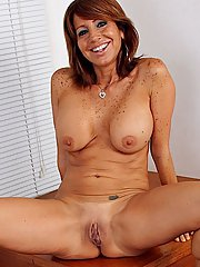 Freckled older Latina babe exposing big natural tits and shaved snatch