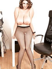 Mesh pantyhose attired office worker unveiling nice melons in high heels