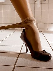 Brandon Jes pulls down pantyhose in bathroom and takes high heels off feet