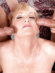 Short haired lady over 50 Honey Ray giving blowjobs in MMF threesome