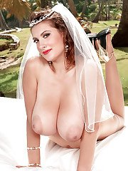 Stocking and garter clad pornstar Valory Irene baring big tits at wedding