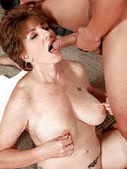 Big boobed granny Bea Cummins riding cock cowgirl style during hardcore sex