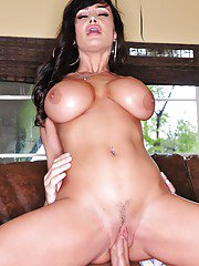 Older brunette Lisa Ann baring huge boobs in skirt during hardcore sex
