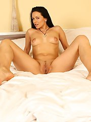 Leggy dark haired babe masturbates MILF pussy while playing with small tits