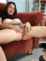 Amateur Asian babe in glasses revealing hairy pussy beneath panties