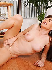 Mature lady Alexandra Silk freeing big boobs and ass from bodystocking