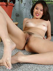 Amateur Asian solo girl with nice ass and legs baring trimmed vagina