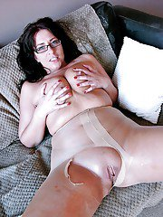 Amateur brunette Amber Rodgers baring big tits in glasses and pantyhose