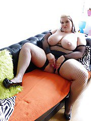 Busty amateur European BBW Sindy Strutt strutting in mesh bodystocking