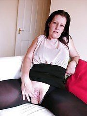Busty amateur Missy Kink spreading shaved pussy in crotchless pantyhose