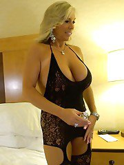 Stocking and lingerie attired housewife displaying huge boobs for babe pics