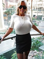 Older blonde housewife Sandra Otterson freeing massive babe type boobs