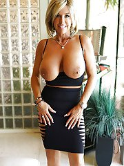 Older blonde housewife Sandra Otterson revealing hooters for babe spread