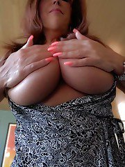 Mature Latina housewife Sandra Otterson flashing huge juggs for babe photos
