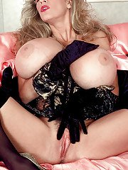 Stocking garbed mature woman Busty Dusty loosing huge tits from lingerie