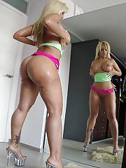 Latina babe Blondie Fesser oiling up big booty in high heels