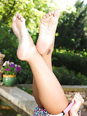 Leggy babe Cheryl S showing off tattoos and sexy barefeet outdoors