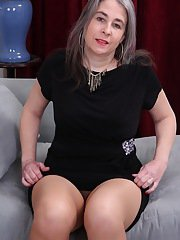 Pantyhose ensconced granny Lexy Lou exposing large tits while undressing