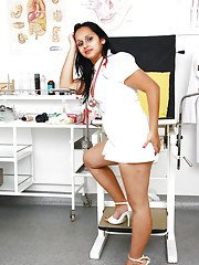 Chubby mature nurse Rosita Black freeing big tits and bush from uniform