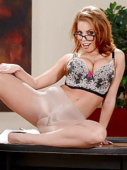 Glasses and skirt adorned babe Britney Amber unveiling big tits in office