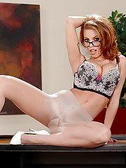 Glasses attired babe Britney Amber showing off nice pantyhose clad ass