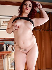 Chubby mature redhead licking own nipples before showing off big butt