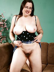 Older fatty in glasses showing off furry underarms and hairy vagina