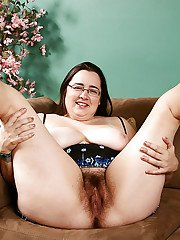 Hirsute fatty in glasses letting huge boobs loose before spreading beaver