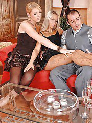 Leggy blondes Sabrina H and Niki Sand giving three way footjob in pantyhose