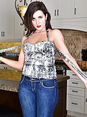 Aged lady Helena Price posing in jeans before stripping naked in kitchen
