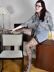 Older Euro lady Corazon Del Angel slipping sexy black nylons over legs