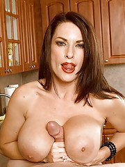Busty European MILF Goldie Blair giving BJ and titty fuck in kitchen