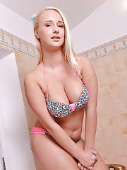 Blonde girl Lilith wetting great tits in bath after bikini removal